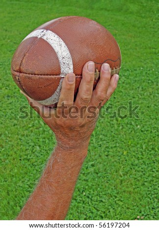 Man Throwing Football - stock photo