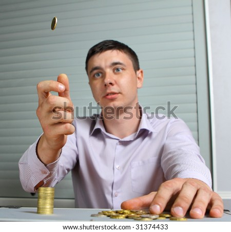 man throwing up a coin - stock photo