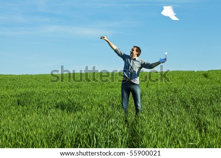 man throws the paper in the field - stock photo
