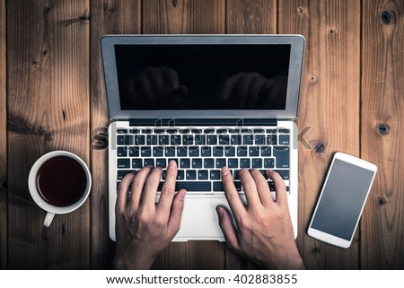 Man to operate the computer - stock photo