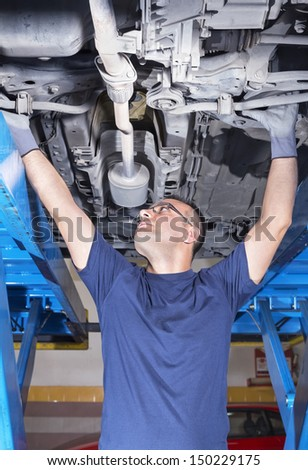 man to work in a machines shop - stock photo