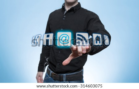 Man touched Virtual email Icon for communication - stock photo
