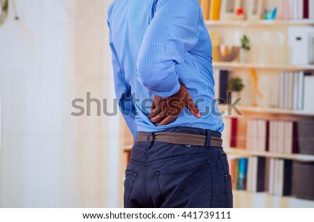Man touching his back, back pain in office is very common