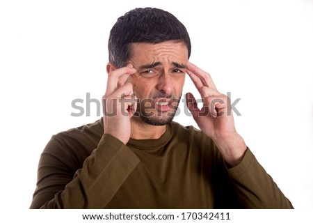 man touching his forehead with his hands to help his headache on a white background - stock photo