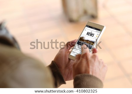 man touching the screen of his smartphone showing news website. All screen graphics are made up. - stock photo