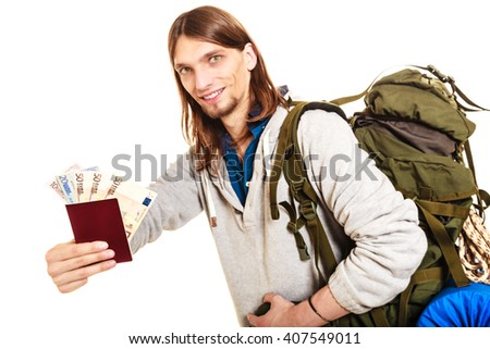 Man tourist backpacker holding passport full of money. Young guy hiker backpacking. Summer vacation travel. Studio shot. Isolated on white background. - stock photo