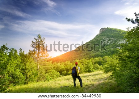 Man tourist in mountain. Leisure activity. - stock photo