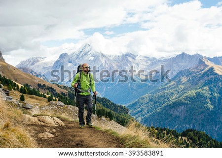 Man tourist walking the mountains with a backpack. Italy, Dolomite