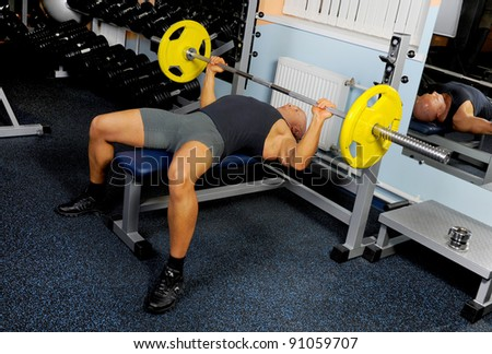 man trained in the gym Bar Bench Press - stock photo