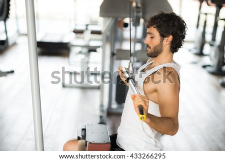 Man training hard in a gym