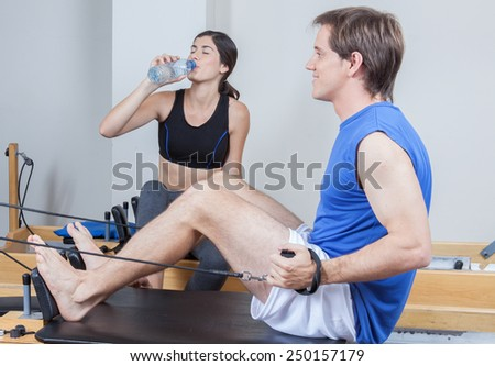 Man training in pilates - stock photo