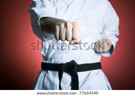 Man training karate at gym, sport and fitness concept - stock photo