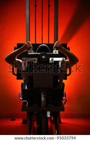 man training on gym isolated on red background - stock photo