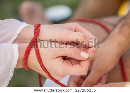 Man Trapped Woman With A  Red Rope - stock photo