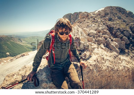 Man Traveler bearded with backpack relaxing Travel Lifestyle concept mountains on background Summer vacations activity outdoor