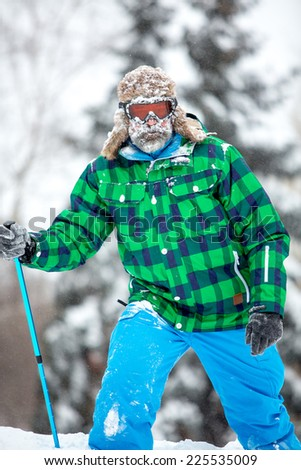 Man traveler hiking in winter in stormy snow weather. Active healthy lifestyle concept - stock photo
