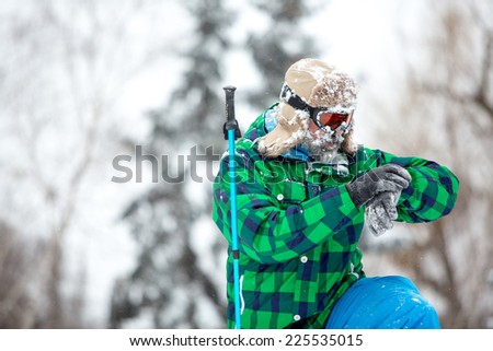Man traveler hiking in winter in stormy snow weather. Active healthy lifestyle concept. copy space - stock photo