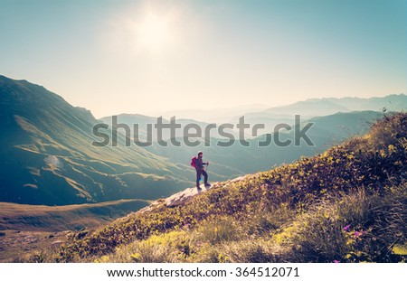 Man Traveler with backpack hiking Travel Lifestyle concept beautiful mountains landscape on background Summer vacations activity outdoor - stock photo
