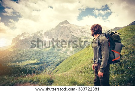 Man Traveler with backpack hiking Travel Lifestyle concept mountains on background Summer journey adventure vacations outdoor - stock photo