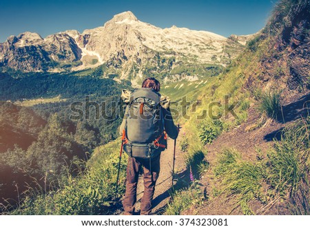 Man Traveler with backpack mountaineering Travel Lifestyle concept mountains on background Summer vacations outdoor - stock photo