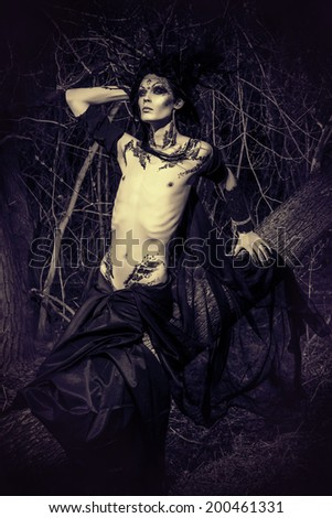 Man-tree in a wild wood. Art project. Fantasy. Halloween. - stock photo