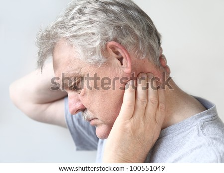 man tries to move his stiff, painful neck - stock photo