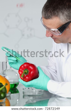 man try to change paprica DNA - stock photo