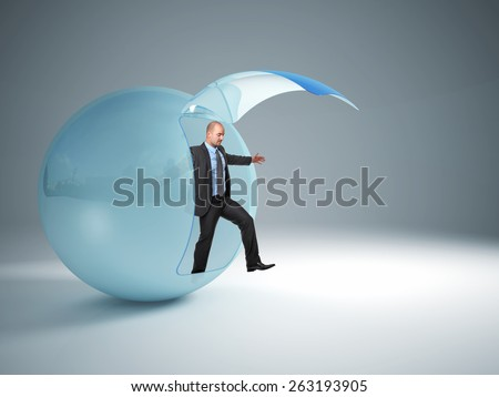 man try to exit from his glass sphere - stock photo
