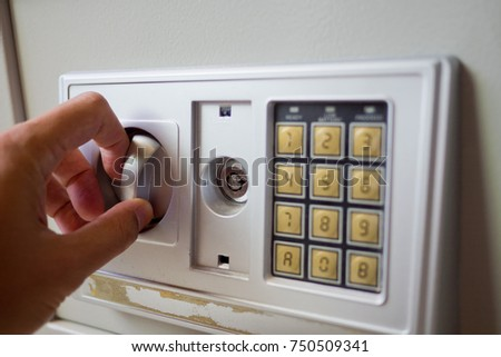 man try to unlock safety box . closeup finger . security box