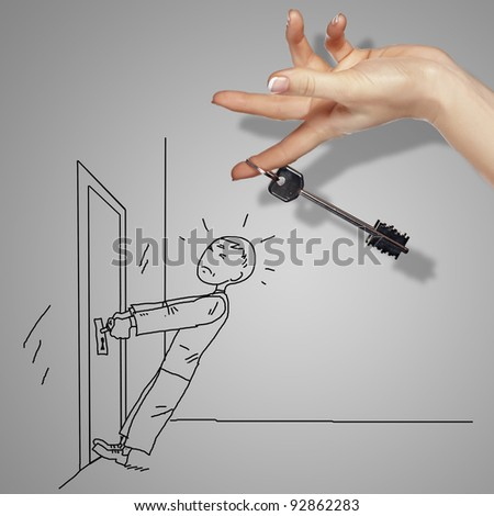 Man tryig to open a door with key - stock photo