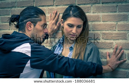 man trying to abuse  his girlfriend - stock photo
