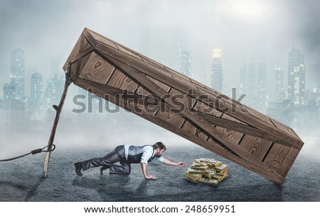 Man trying to get money in trap - stock photo