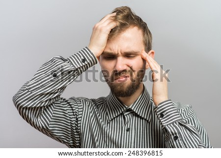 man trying to remember something with headache - stock photo