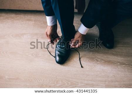man tying shoelaces - stock photo