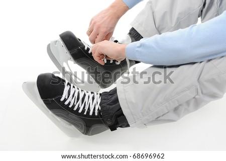 Man tying shoelaces hockey skates. Isolated on white background - stock photo