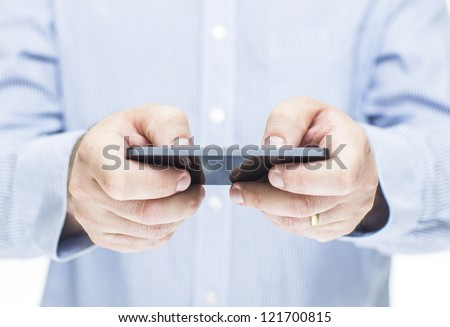 Man typing a message on a mobile phone - stock photo