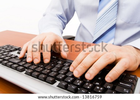 Man typing in the computer keyboard