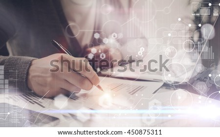 Man Typing Keyboard Laptop Hand.Project Manager Researching Process.Business Team Working Startup modern Office.Global Strategy Virtual Icon.Innovation Graphs Interfaces.Analyze market stock.Blurred - stock photo