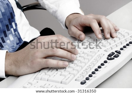Man typing on a computer keyboard - stock photo