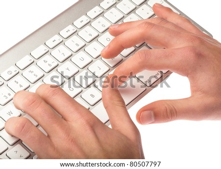 man typing on a keyboard on white background