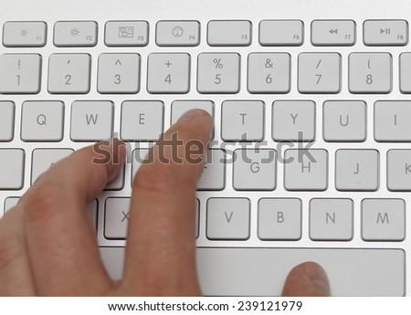 man typing on keyboard - stock photo