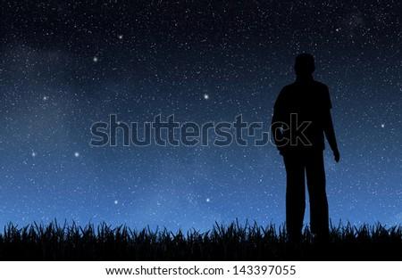 Man under the night sky - stock photo