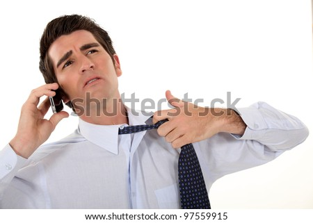 Man undoing his tie. - stock photo