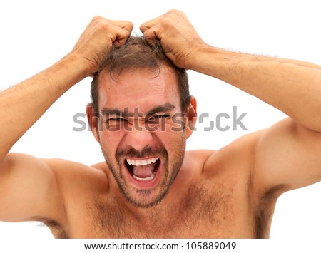 man upset and pulling his hair on a white background - stock photo