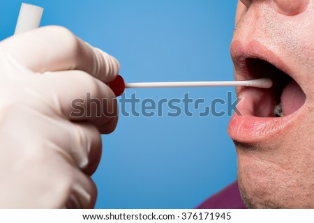Man use a DNA test tube and cotton swab, wipe test