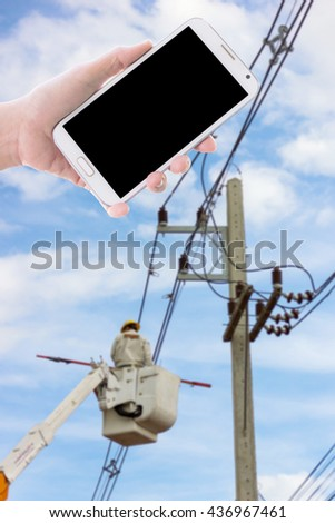 Man use mobile phone, blur image of electrician repair the transmission system as background.
