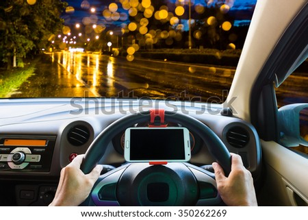 Man use mobile phone in the car on the road.