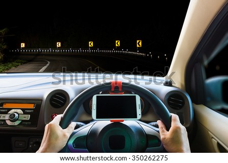 Man use mobile phone in the car on the road. - stock photo