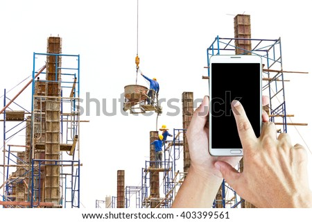 Man use mobile phone, workers were pouring concrete pillar of the building as background. - stock photo
