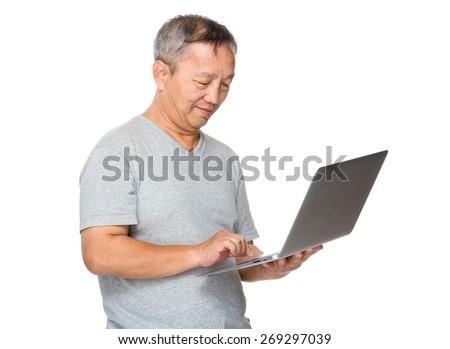 Man use of laptop computer - stock photo